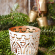 White candle holder with oriental ornaments among fir branches — Stock Photo #72852877
