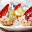 Cupcakes decorated with fresh fruits — Stock Photo #73079667