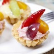 Cupcakes decorated with fresh fruits — Stock Photo #73079677