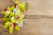 Beautiful yellow orchid flowers on wood — Stock Photo