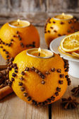 Orange pomander ball with candle decorated with cloves in heart  — Foto de Stock