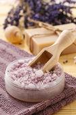 Wooden scoop with lavender sea salt — Stock Photo