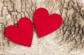 Red hearts on bark background. Symbol of love — Stock Photo