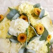 Beautiful bouquet of yellow and white carnations — Stock Photo #79329790