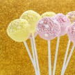Pink and yellow cake pops decorated with sprinkles. — Stock Photo #80865780