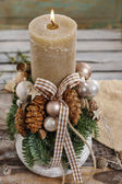 Christmas decoration with candle and cones — Stock Photo