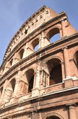 Majestic ancient Colosseum in Rome against blue sky, Italy — Стоковое фото
