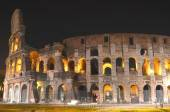 Majestic ancient Colosseum by night in Rome, Italy — Stock Photo