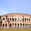 Monumental ancient Colosseum in Rome against blue sky, Italy — Stock Photo #56370749