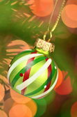 Christmas decoration, Christmas ball hanging on spruce twig against bokeh background — Stok fotoğraf