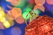 Christmas decoration, red Christmas ball on bokeh background — Stock Photo