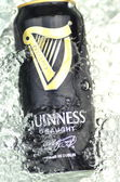 Guinness draught beer in splashed water — Stock Photo