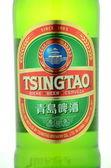 Tsingtao beer isolated on white background — Stock Photo