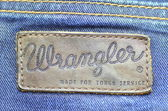 Closeup of Wrangler label on blue jeans — Stock Photo