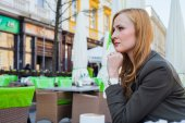 Young elegant woman sitting in a cafe — Stock Photo