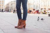 Slim model legs in blue jeans. — Stock Photo