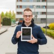 Young man with tablet pc on street — Stock Photo #55760343