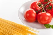 Fresh red tomatoes and pasta — Stock Photo