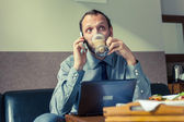 Man using mobile phone during breakfast — Stock Photo