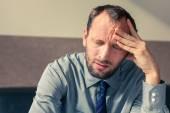 Stressed businessman getting headache — Stock Photo