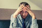 Stressed businessman getting headache — Foto Stock