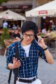 Asian man with mobile smartphone — Stock Photo