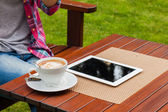 Woman hands with tablet computer and coffee — Stock Photo
