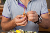 Young man  eating seafod. — Stock Photo