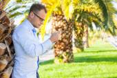Young tourist  with mobile phone — Stock Photo