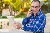 Tourist  with mobile tablet pc and mobile — Stock Photo