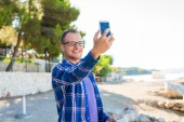 Tourist with mobile phone and tablet pc — Stock Photo