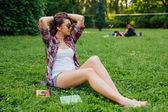 Brown hair girl spending free time — Stock Photo