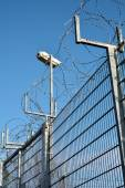 Video surveillance and barbed wire — Stock Photo