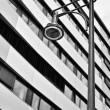 Office building with street lamp — Stock Photo #75565243
