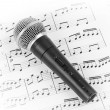 Dynamic microphone on music sheet. — Stock Photo #58871105