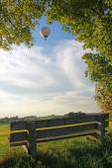 Bench in rural landscape, balloon — Stock Photo