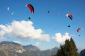 Group of paragliders in mountainous landscape — Stock Photo
