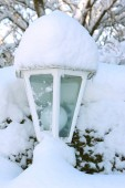 Snowy garden lantern — Stock Photo