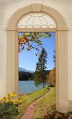 View through arched door, autumnal hiking trail — Stock Photo