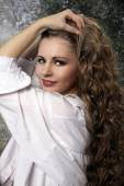 Young long-haired curly blonde woman — Stock Photo