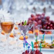 Banquet table with fruits, juice and snacks close up — Stock Photo #65515289