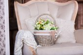Basket with tulips on vintage chair — Stock Photo
