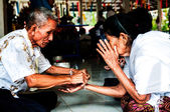 Nongkhai, THAILAND - OCTOBER 08 : Bind the holy thread in Thai r — Stock Photo