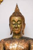 Closed up Old gold buddha statue — Stockfoto