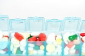 Medicine in weekly pill box — Stock Photo