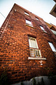 High Apartment Block and Brick Wall in the Poor Trois-Riviere Ar — Stock Photo