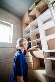 Woman Applying the First layer of Paint on a Wooden Library  — Fotografia Stock