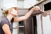Closeup of Woman Painting Kitchen Cabinets — Stock Photo