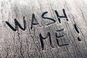 Wash Me Words on a Dirty Car Window — Stock Photo