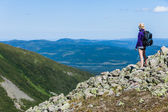 Young Woman Looking at the View From the Top of the Hill — Stock Photo